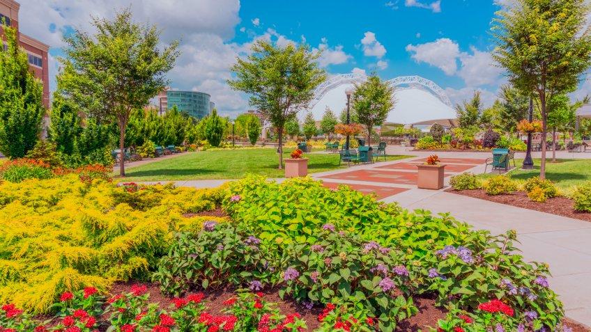 brick path in park, Five Rivers Metropark, Metropark, flower planters in park.