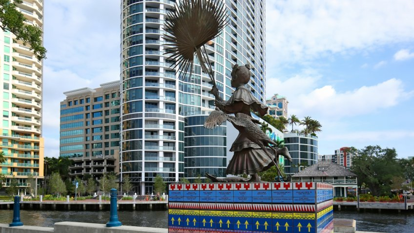 "FORT LAUDERDALE, FL - MAY: Tall life-sized bronze statue titled ""Florida, a Seminole Girl"" located at Stranahan Landing, directly across the New River from the Stranahan House as seen May 10, 2018."