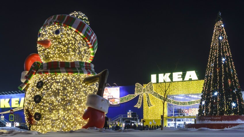 "Novosibirsk, Russia - December 17, 2016: new year's decoration of shop ""IKEA"" on the big snowman of the bulbs and Christmas tree with garlands at the entrance to Novosibirsk 17 Dec 2016."