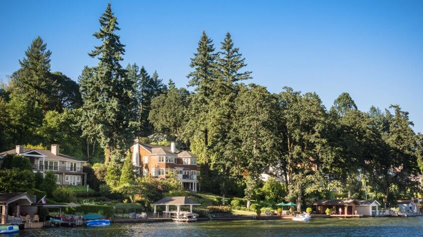 Wealthy home owners enjoy their manshions with boat houses along the beautiful shores of Lake Oswego in Oregon.
