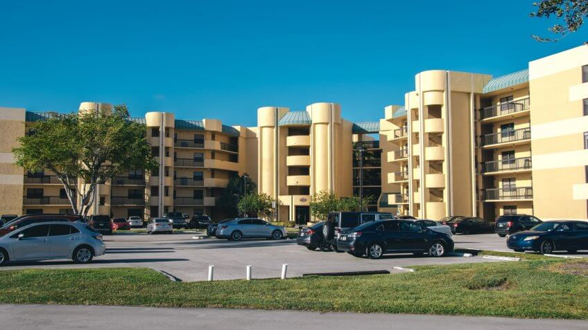 Lauderhill, Florida/USA - September 26, 2019: Modern Yellow color Building Apartments Condo in Lauderhill, available for rent.