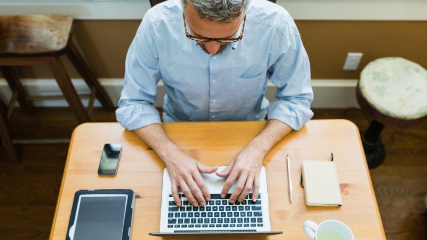 man working using laptop at home.