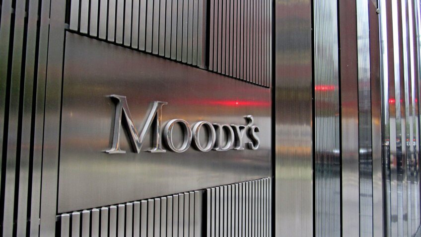 New York, NY/USA-May 3, 2019: Red light is reflected in the stainless steel facade of 7 World Trade Center and the Moody's Investor Services sign.