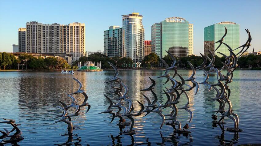 ORLANDO, FLORIDA - MAY 21st: Sculpture art of seagulls taking flight at Lake Eola Park in Orlando, Florida on May 21st, 2016.