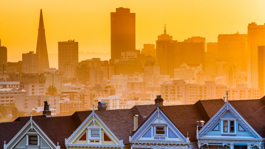 San Francisco California sunrise skyline with painted ladies houses