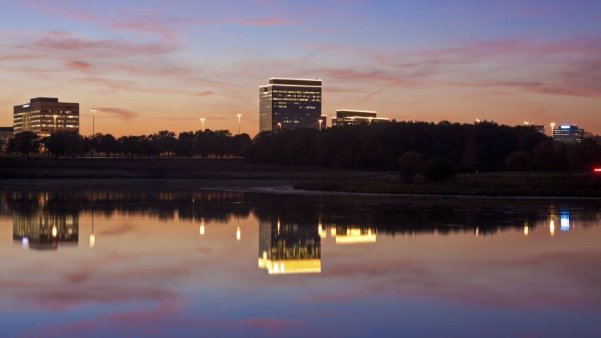 Schaumburg, Illinois - office buildings reflected in the lake.