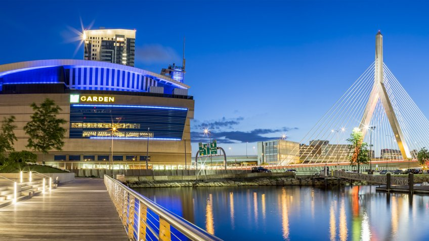 BOSTON, USA - JUNE 20: The architecture of Boston in Massachusetts, USA at night showcasing the Famous Zakim Bridge and the TD Garden stadium at night on June 20, 2017.
