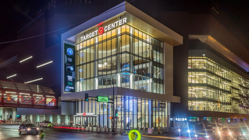 MINNEAPOLIS, MN - JANUARY 2019 - A Wide Angle Shot Traffic in front of the Target Center before a Timberwolves Game during a Winter Night - Image.