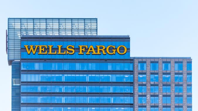 Atlanta, USA - April 20, 2018: Downtown Georgia city skyscrapers during day with modern buildings, business, Wells Fargo Bank closeup.