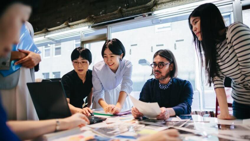 Group of people are working together in a modern working space in Tokyo.