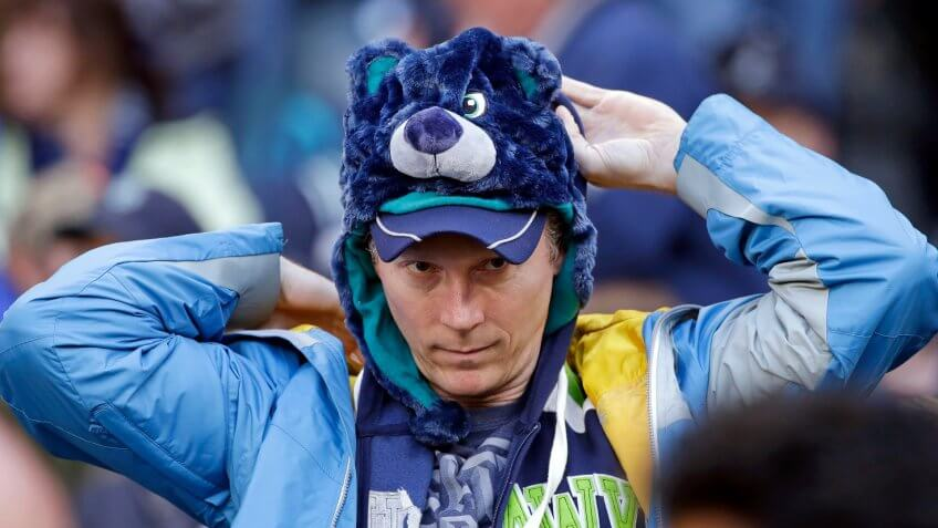 baseball fan wearing Hisashi Iwakuma bear hat from team promotion