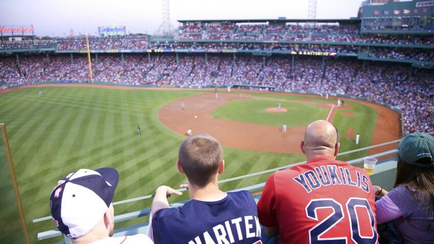baseball fans watch from upper deck at Fenway Park