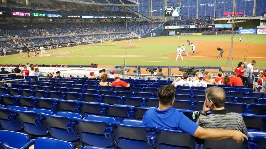 baseball fans watching game with empty stadium
