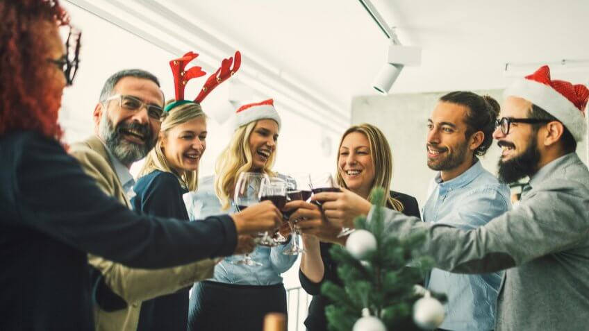 Business people celebrating Christmas At Workplace.