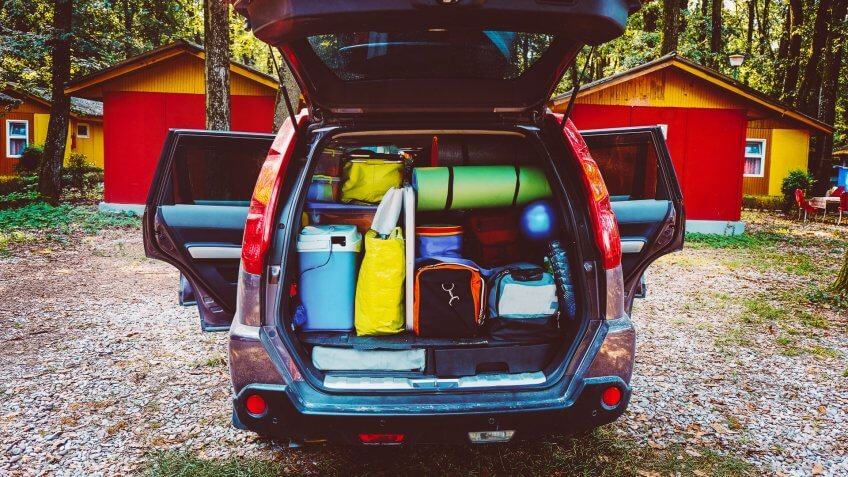 car packed with camping gear