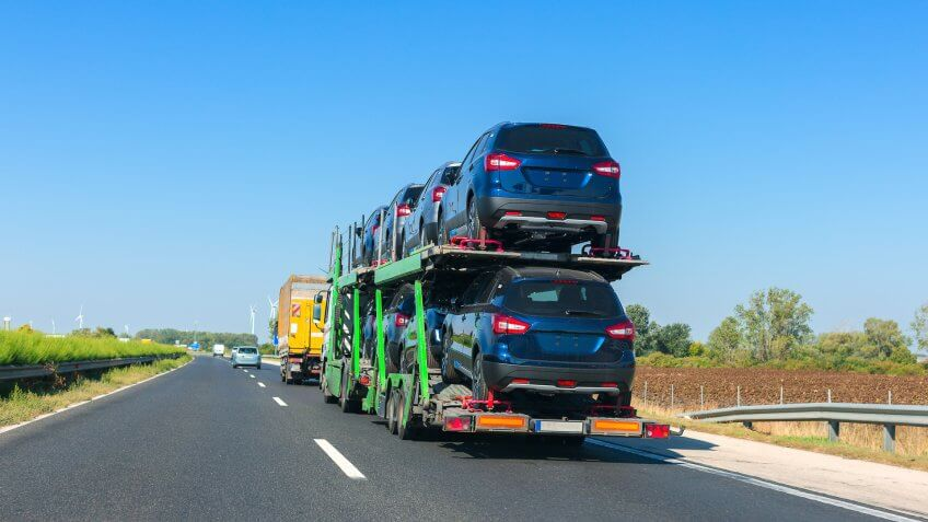 cars being transported by semi-truck