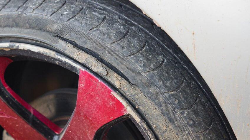 curb rash damage on tire and rim