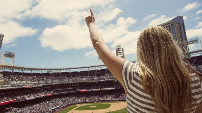female baseball fan yelling at baseball team