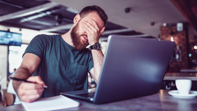 Male Accountant Tired After Lots Of Work.