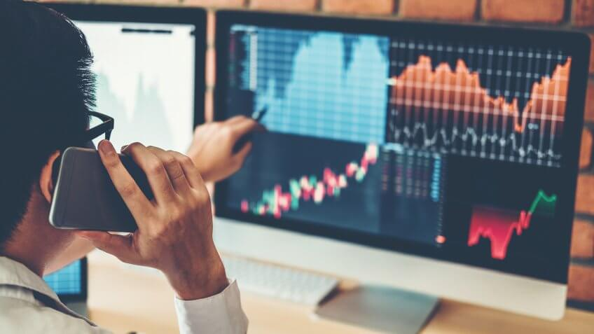 Investment stock market  Entrepreneur Business Man discussing and analysis graph stock market trading,stock chart concept.