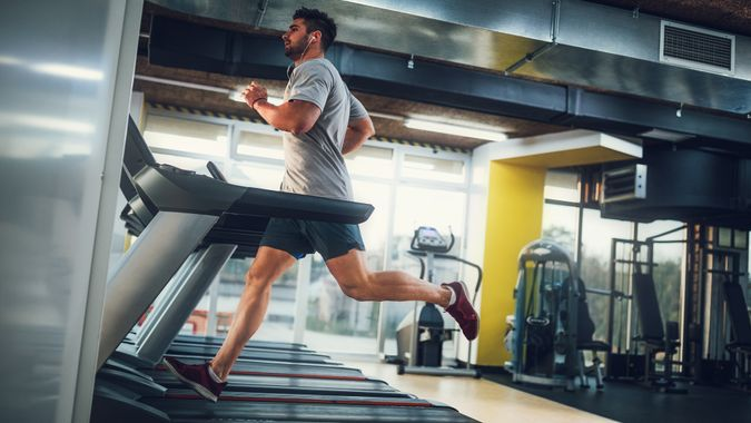 Male running on treadmill at the gym.