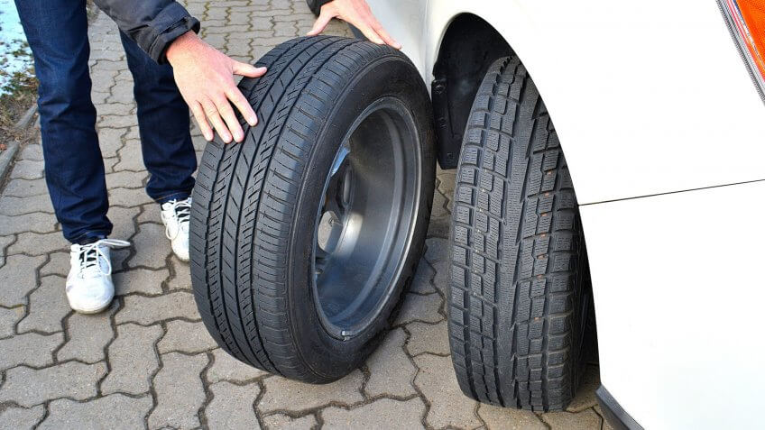 mechanic with multiple types of tires