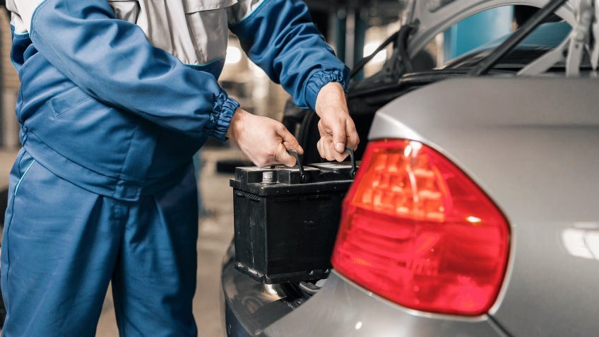mechanic swapping car battery