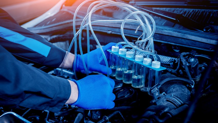 mechanic using fuel injection cleaning system