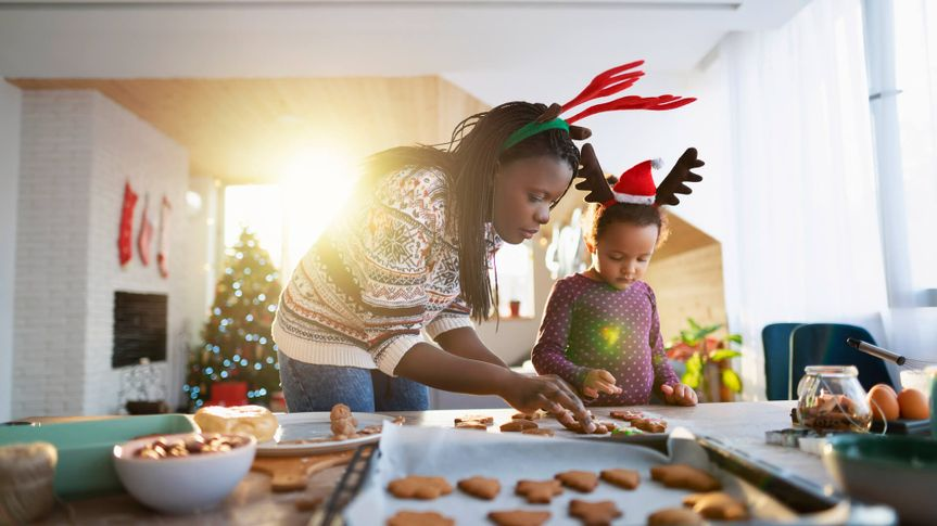 Mother making Christmas cookies with her daughter.