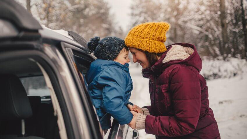 Mother and son on a winter road trip.