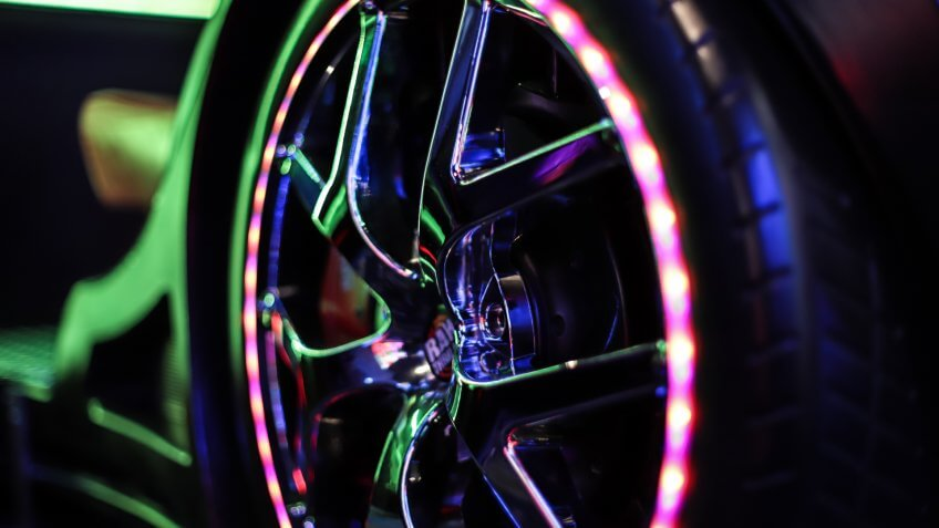 Seattle, Washington/USA - September 29, 2019 - Closeup of neon lights of a tire car driving simulator in an arcade games center.