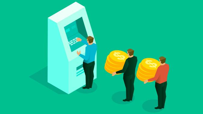 Savings, businessman holding gold coins standing in front of ATM machine waiting.