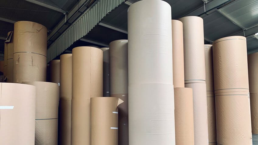 Spools of paper in the generic corrugated board plant.