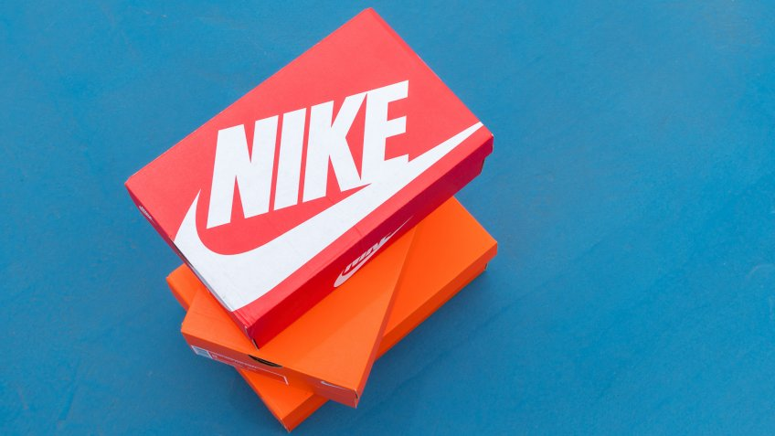 stack of Nike shoes boxes