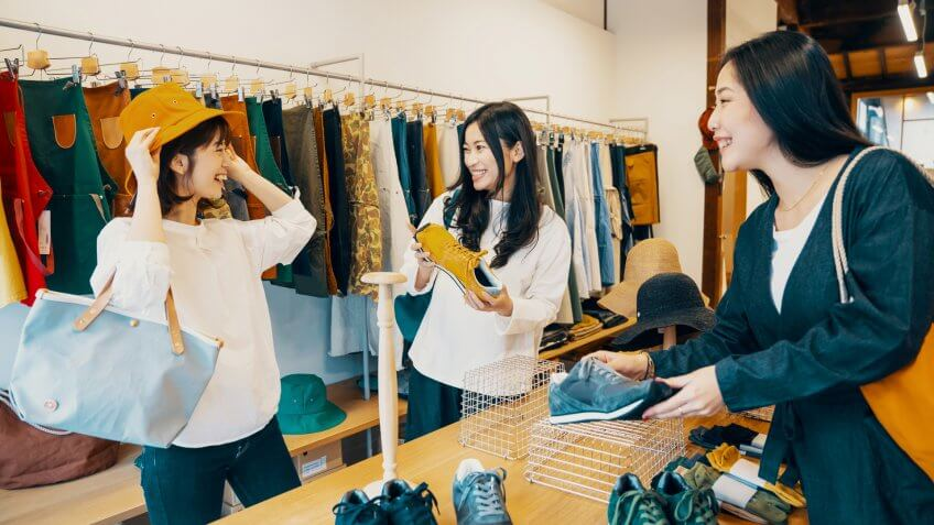 Three women shopping together in a clothing store in Japan.