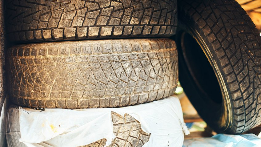 A pile of old, worn tires.