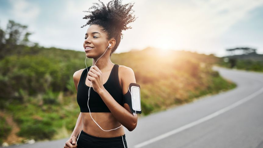 Shot of a sporty young woman running outdoors.