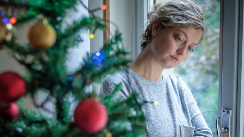 Woman feeling alone during christmas holiday.