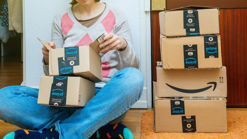 woman opening up Amazon delivery boxes