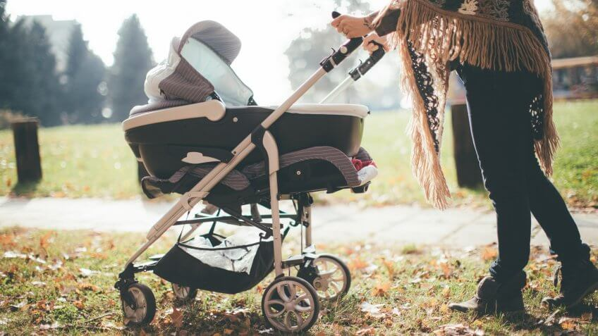 Young mother with a baby stroller.