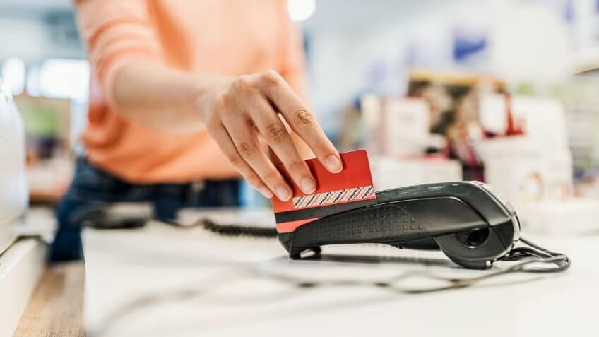 Customer paying with contact less card.