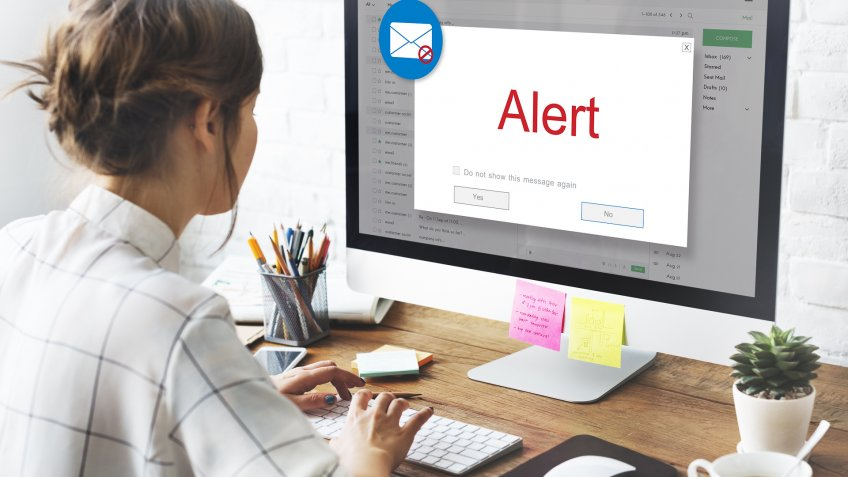 woman with email alert on computer