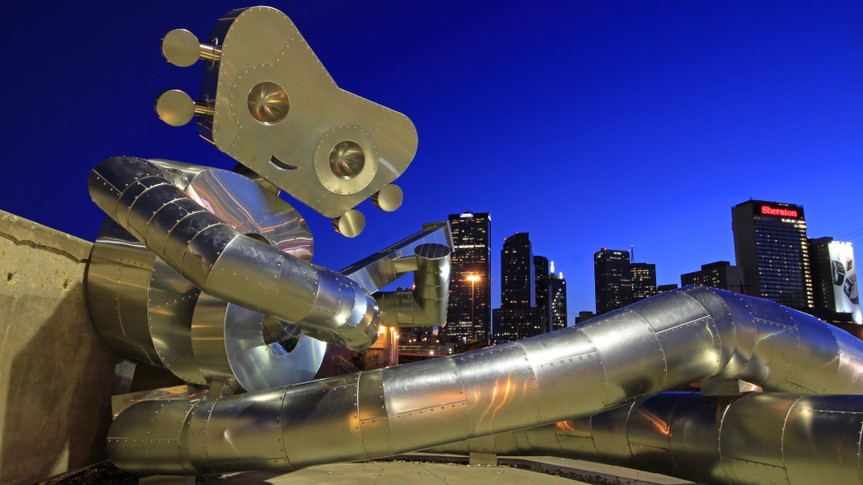 DEEP ELLUM STATION, DALLAS JUNE 6: The DART Train Station is home to a three-part stainless steel sculpture series called The Traveling Man by local artist Brandon Oldenburg.