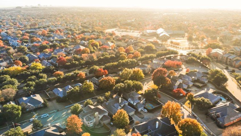 Aerial view urban sprawl with colorful fall foliage near Dallas, Texas, USA.