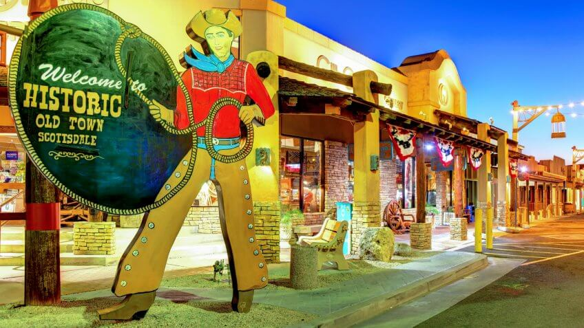 Scottsdale, Arizona, USA - March 9, 2019: The City owned iconic Old Town Scottsdale cowboy welcome sign located in the Old Town district.