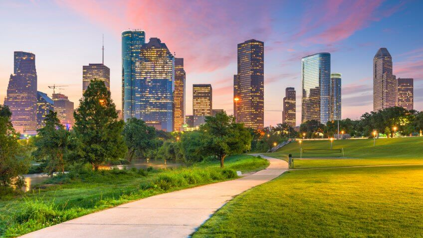 Houston, Texas, USA downtown city skyline and park at dawn.