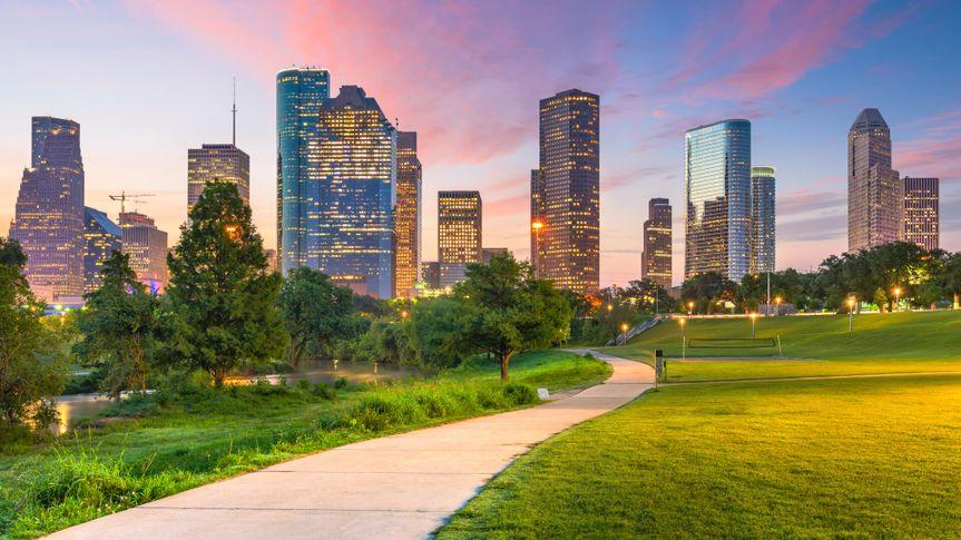 Houston, Texas, USA downtown city skyline and park at dawn.