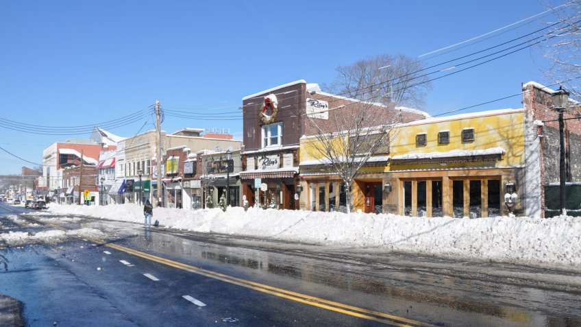 HUNTINGTON, NEW YORK - FEB 9: Huntington Village shopping district main streets cleared less than 24 hours after the Feb 8 blizzard that dumped 1-2 ft of snow on Huntington, New York.