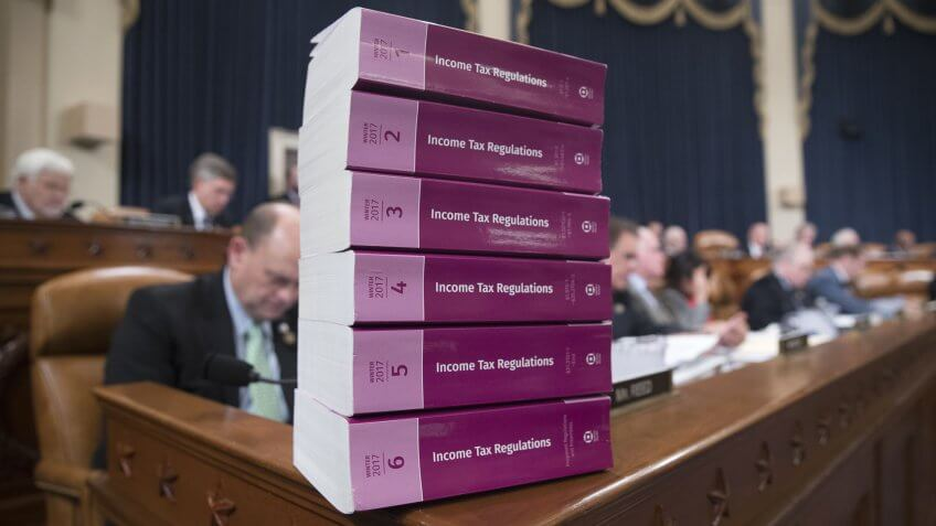 Mandatory Credit: Photo by Michael Reynolds/EPA-EFE/Shutterstock (9201576a)Books entitled 'Income Tax Regulations' are stacked in the room before the start of the House Ways and Means Committee markup on a Republican-crafted tax reform plan, on Capitol Hill in Washington, DC, USA, 06 November 2017.
