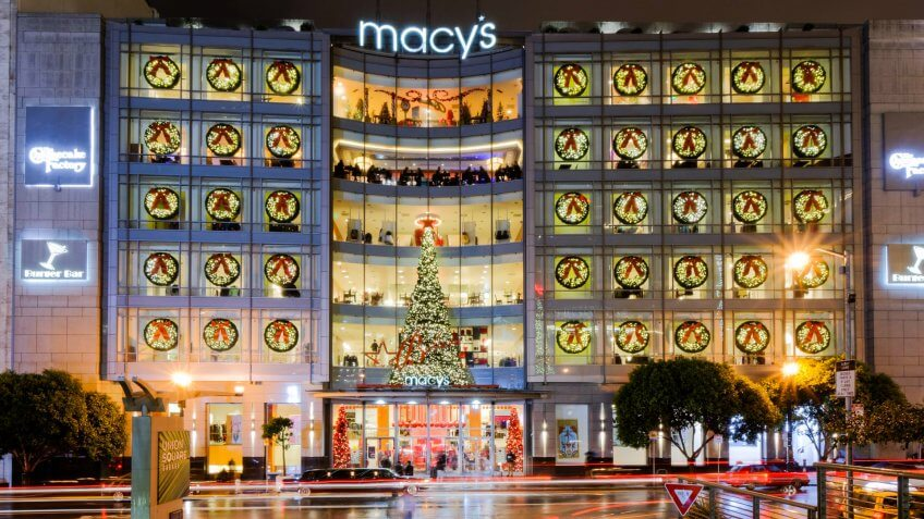 SAN FRANCISCO, CA - NOVEMBER 30: Macy's store illuminated with lights and Christmas tree at Union Square, San Francisco on November 30, 2014 in San Francisco, California.